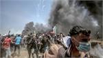 Tension in Gaza as Palestinians begin to bury 58 dead