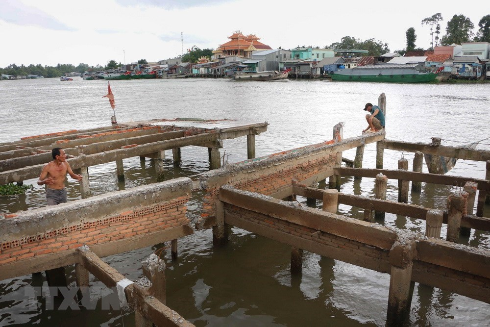 Can Tho: Houses eroded, people on knife-edge, Vietnam environment, climate change in Vietnam, Vietnam weather, Vietnam climate, pollution in Vietnam, environmental news, sci-tech news, vietnamnet bridge, english news, Vietnam news, news Vietnam, vietnamne