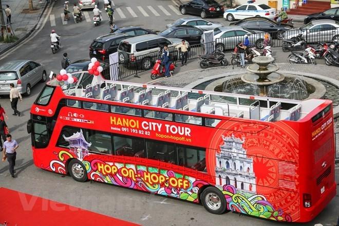 Double-decker Hanoi tour gains tourists' favour