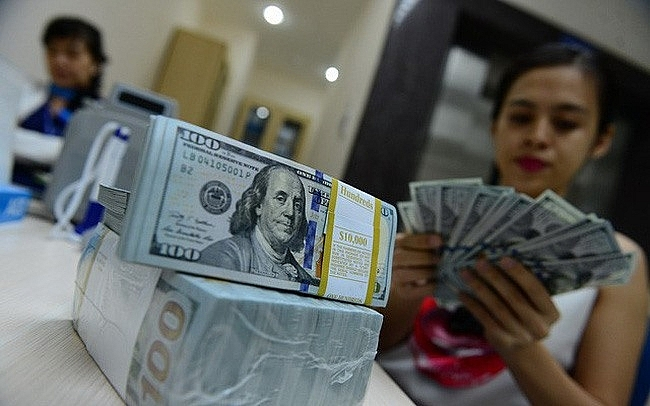 Dollar hike won't significantly affect VN's economy, vietnam economy, business news, vn news, vietnamnet bridge, english news, Vietnam news, news Vietnam, vietnamnet news, vn news, Vietnam net news, Vietnam latest news, Vietnam breaking news