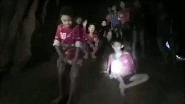 The boys trapped, Thai cave,  found by divers, still alive