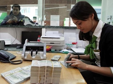 VND to depreciate by 3% at most in 2018: BVSC, vietnam economy, business news, vn news, vietnamnet bridge, english news, Vietnam news, news Vietnam, vietnamnet news, vn news, Vietnam net news, Vietnam latest news, Vietnam breaking news