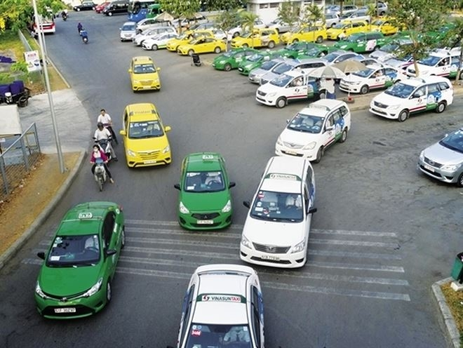 Putting ride-hailing and taxi firms under same hat could blunt growth
