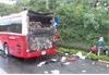 Tourists run from coach fire